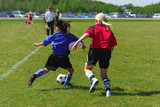 Two youth soccer players in action poster
