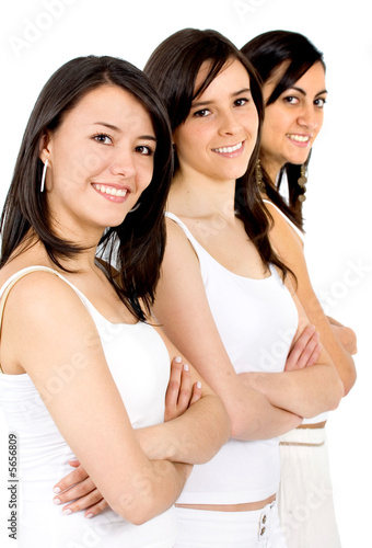 beautiful girl friends smiling and dressed in white isolated