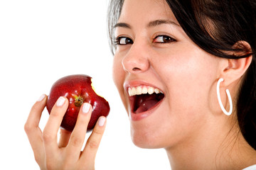 girl eating an apple isolated over a white background