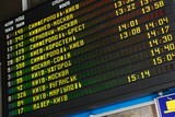 Schedule board of a railway station with cyrillic letters poster