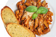 Penne pasta meal with garlic bread