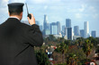 Security agent watching Los Angeles from hilltop