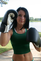 Fighting woman with boxing gloves