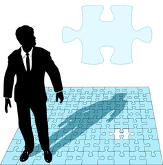 Business man  works the missing piece of a puzzle solution.