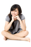 A cute Asian teenager sitting on white background poster