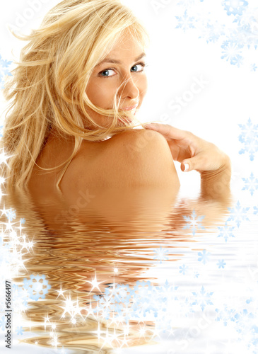 portrait of happy blond in water with snowflakes