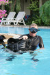 Scuba diving instructor in a swimming pool.