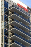 Close up view of balconies of highrise apartment building poster
