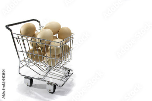 Brown eggs stacked in a small shopping cart