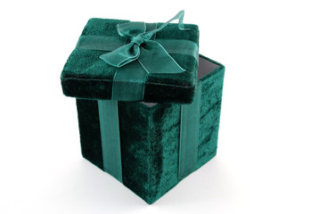 Green gift box with a laced up bow