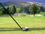 Golf club and ball on the tee with the fairway in the distance. poster