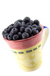 Blueberries in a mug.
