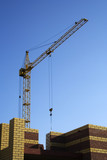 The elevating crane on construction of a new building. poster