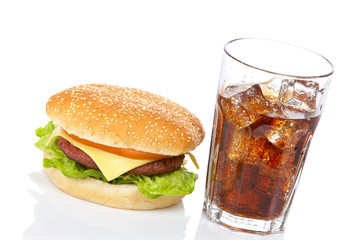 Cheeseburger and soda, on white background. Shallow DOF