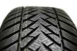 Brand new tire on white background poster