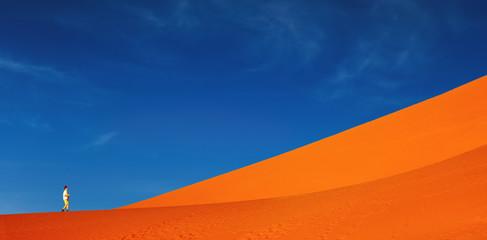 Sand dune climbing, Namib Desert, Sossusvlei, Namibia.