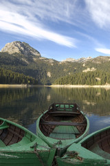 Three boats for fishing on the mountain lake