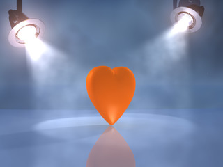 Orange heart on the foggy stage