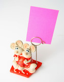 Two mousies from porcelain with a clip for cards. poster