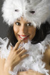 nice brunette with white feather mask and red lips making face