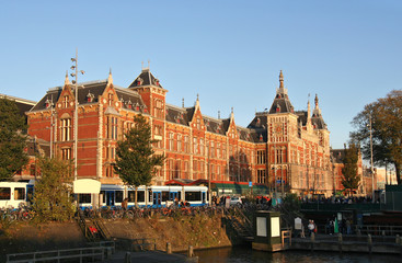 Amsterdam Central Station and trams in the evening sun