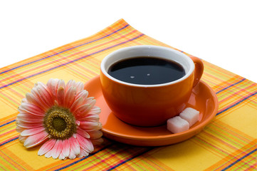 cup of coffee with a suger and flower