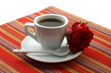 white cup of coffee with a red rose on white background