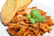 Penne pasta in a tomato sauce with garlic bread