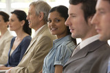 Young businesswoman in seated line of colleagues