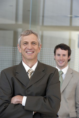 Mature businessman with colleague
