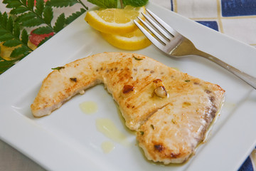 grilled swordfish filet with garlic sauce and lemon