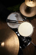 canvas print picture - drum set in dramatic light on a black background