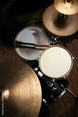canvas print picture drum set in dramatic light on a black background