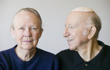 Close-up of eldery Jewish couple in studio.