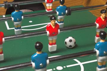 A miniature tabletop foosball arcade type game.