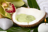 Avocadococonut scrub in coconut shell, orchid flower candles.  poster
