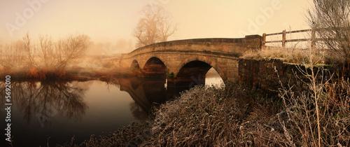 bridge over river in mist