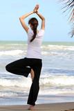 Fototapety Yoga auf dem Strand