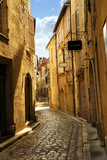 Narrow medieval street in town of Perigueux