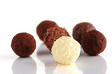 Several assorted chocolate truffles isolated on white background poster