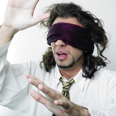 Blindfolded man