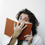 Man hiding behind book poster