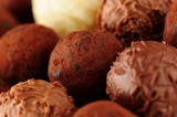 Several assorted gourmet chocolate truffles close up poster