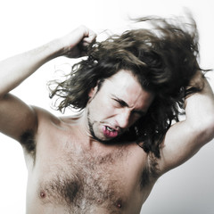Young man brushing long hair