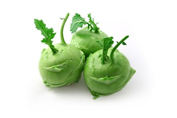 Three kohlrabi heads on a white background