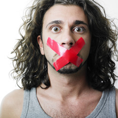 Man with red censor tape