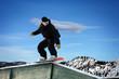 Snowboarder sliding on a rail at Lake Tahoe
