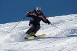 freeride skiing in powder snow against blue sky poster