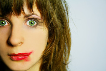 Woman with green eyes and smeared make up