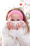 Sweet little girl in white pullover, covering her face poster